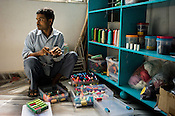 A worker takes inventory of colour threads at Sophie 203 workshop in Jaipur, Rajasthan, India.