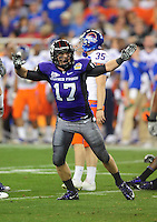 Jan. 4, 2010; Glendale, AZ, USA; TCU Horned Frogs safety (17) Tyler Luttrell celebrates a missed field goal by the Boise State Broncos in the first quarter in the 2010 Fiesta Bowl at University of Phoenix Stadium. Boise State defeated TCU 17-10. Mandatory Credit: Mark J. Rebilas-