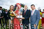 Siobhan McCarthy, Killarney receives the Best Dressed Lady prize from Chairman Of Dawn Dairies, Donal Pierse, with judges Thalia Heffernan and Aidan O'Mahony at the killarney Races on Thursday