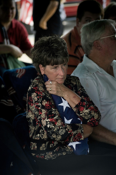 August 26, 2007. Kinston, NC.. A funeral for  Spc. Steven R. Jewell was held at the Pine Lawn Memorial Park in Kinston, NC. Spc. Jewell was killed in a helicopter crash near the Iraqi city of Fallujah on August 14, 2007.. Cindy Wisener, Spc. Jewell's mother, cries over the flag presented to her by the attending army general..