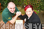 WRESTLING: Practising their Arm Wrestling techniques are Paul Lowth (Owner Huddle Bar) and Geraldine Quirke (Carers Association).