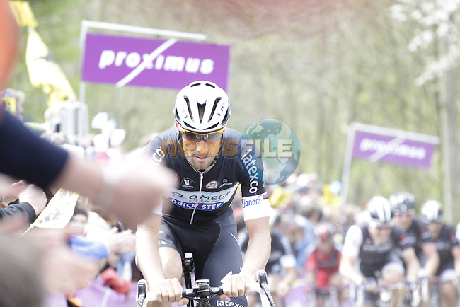 Tom Boonen (BEL) Omega Pharma-Quick Step climbs the Molenberg during the 2014 Tour of Flanders, Belgium.<br /> Picture: Eoin Clarke www.newsfile.ie