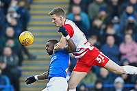 Paul Downing of Doncaster Rovers wins a header from Omar Bogle of Portsmouth during Portsmouth vs Doncaster Rovers, Sky Bet EFL League 1 Football at Fratton Park on 2nd February 2019