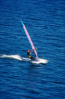 A windsurfer sails his board on Deer Creek Reservoir. water sports, sailing, boats Connotation - Speed. Utah, Deer Creek Reservoir.