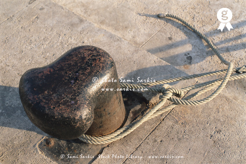 Rope tied around bollard, close-up (Licence this image exclusively with Getty: http://www.gettyimages.com/detail/200387967-001 )