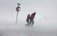 (2/12/06  Hull, MA ) Barbara Kiley and Charlie Hammer, right,  fight the intense winds (and debris) in whiteout conditions along Nantasket Avenue while out for a stroll near  Edgewater Avenue in Hull during the big storm on Sunday, February, 12 2006.  (_C2D7313.JPG   Staff Photo by Matthew West.  Saved in Monday)