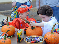 """From left, Aiden Vettraino, 5 of Newtown, Pennsylvania and Mia LaFrado, 5 of Holland, Pennsylvania paint pumpkins during the Fifth Annual """"Safe Trick or Treat"""" at General Electric Saturday October 24, 2015 in Bensalem, Pennsylvania. (Photo by William Thomas Cain)"""