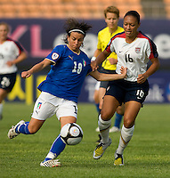 USWNT midfielder (16) Angela Hucles is held off by Italy's (18) Pamela Conti during the last group stage game at the Peace Queen Cup.  The USWNT defeated Italy, 2-0, at the Suwon Sports Center in Suwon, South Korea.