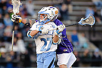 Baltimore, MD - April 5: Midfielder Rob Guida #27 of the John Hopkins Blue Jays fires on the cage during the Albany v Johns Hopkins mens lacrosse game at  Homewood Field on April 5, 2012 in Baltimore, MD. (Ryan Lasek/Eclipse Sportwire)