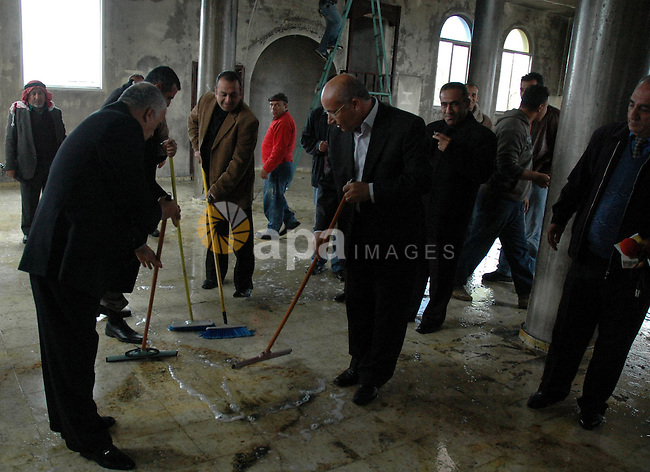 Palestinians cleaning the mosque, which was burned by Israeli settlers in the village of Yasouf in the West Bank city of Nablus on Dec 14 , 2009. Photo by Nedal Shtieh