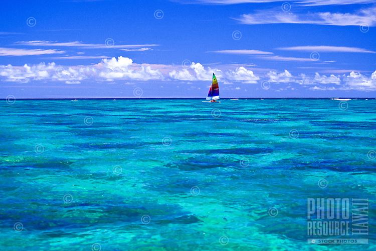 Colorful sailboat sailing in clear water near Lanikai beach