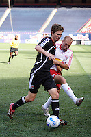 Red Bulls midfielder (13) Clint Mathis battles for the ball with DC United defender (32) Bobby Boswell. The New York Red Bulls defaeted D. C. United 1-0 in an MLS regular season match at Giants Stadium, East Rutherford, NJ, on July 22, 2007.