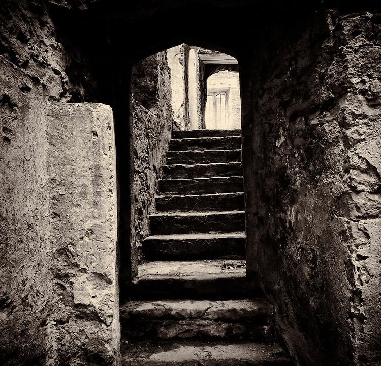 Doorway and steps in medieval castle ruins. Beupre Castle, Wales