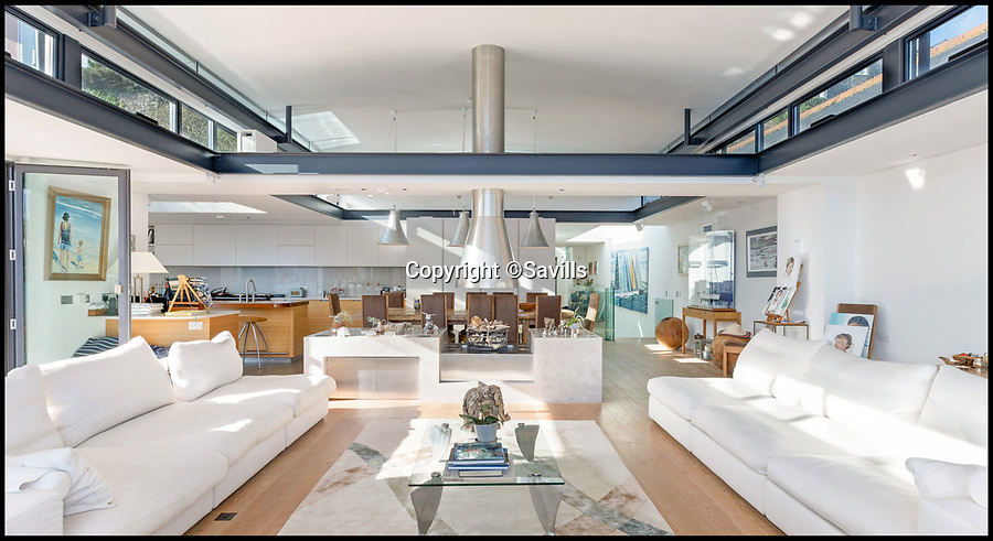 BNPS.co.uk (01202 558833)<br /> Pic: Savills/BNPS<br /> <br /> Stunning interior...<br /> <br /> An award-winning waterfront home that has spectacular seaside views has gone on the market for £5m.<br /> <br /> The aptly named River House sits right on the Dart Estuary in Devon and has been so cleverly designed there is a glass floor in the master bedroom that looks down on the water.<br /> <br /> Its main living areas have floor-to-ceiling bi-fold doors and glass Juliet balconies to give the property a feel of Venice rather than Devon.<br /> <br /> Interestingly, the five bedroom house is being sold along with a nearby two bedroom town house that is owned by the same vendors.