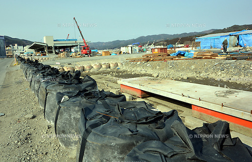 March 9, 2013, Kesennuma, Japan - Reconstruction efforts continue at this fishing port of Kesennuma, Miyagi Prefecture, on March 9, 2013, nearly two years after the port was devastated in the March 11 diaster. Two years ago on March 11, the Magnitude 9.0 earthquake and ensuing tsunami struck the nation's northeast region, leaving more than 15,000 people dead and ravaging wide swaths of coastal towns and villages.  (Photo by Natsuki Sakai/AFLO)