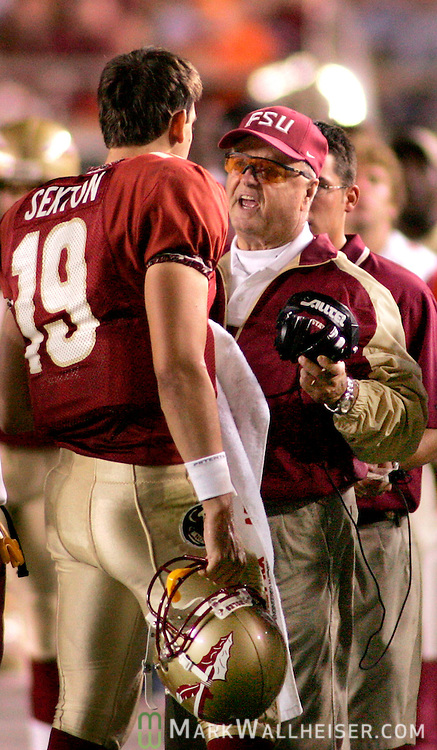 Florida State head coach Bobby Bowden (R) talks to quarterback Wyatt Sexton (19) late in the second quarter in Tallahassee October 16, 2004.  Sexton threw a touchdown strike on the next play against Virginia.