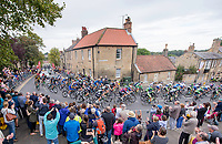 Picture by Allan McKenzie/SWpix.com - 04/09/2017 - Cycling - OVO Energy Tour of Britain - Stage 2 Kielder Water to Blyth - The peloton passes through Warkworth.