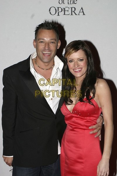 "TOBY ANSTIS & HAYLEY EVETTS.""The Phantom of the Opera"" World Premiere,.Grand Hotel Olympia, London, December 6th 2004..half length red satin dress.Ref: AH.www.capitalpictures.com.sales@capitalpictures.com.©Capital Pictures."