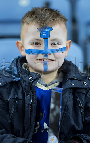 01.03.2016. King Power Stadium, Leicester, England. Barclays Premier League. Leicester versus West Bromwich Albion. A young Leicester City fan with his face painted in the Leicester City colours and Leicester City striker Jamie Vardy shirt waits for the start of the match in the stands.