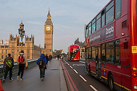 UK, England, London.  Early Morning Pedestrians and Buses on Westminster Bridge.