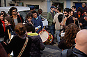 """Lisbon, Portugal. 21.03.2015. A """"Batucada"""" Tavern Crawl is held in the Mouraria district of Lisbon. People gather to make music in the streets, accompanied by percussion instruments such as drums, tambourines, etc. whilst revellers follow, dancing, singing, eating and drinking and others watch on from their balconies. """"Batucada"""" is a Brazilian form of accompaniment to music such as Samba. It comes from the verb """"Batucar"""" which means """"to hammer"""". The event is part of a community effort to improve the local area by Mouradia – Casa Comunitária da Mouraria. Photograph © Jane Hobson."""