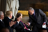 Senate Minority Leader Chuck Schumer, a Democrat from New York, greets former Senator Bob Dole, during a congressional Gold Medal ceremony for Dole, in Washington D.C., U.S., on Wednesday, Jan. 17, 2018. From left: U.S. Vice President Mike Pence, U.S. President Donald Trump, Dole, and Schumer. Photographer: Al Drago/Bloomberg<br /> Credit: Al Drago / Pool via CNP
