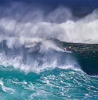Bodyboarder on a spectacular size wave at Banzai PipelineonNorth Shore of Oahu.