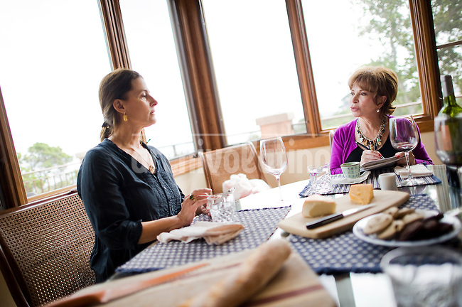 Writer Isabel Allende(R) speaks with her personal assistant Juliette Ambatzidis during lunch at her home in San Rafael, CA Monday March 25th, 2013....Chilean writer Isabel Allende at her home in San Rafael, California. From a well known family of politicians, Allende is one of the more World wide known writers in Spanish languague