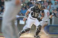 Jose Queliz (30) of the Hillsboro Hops waits for the throw at home plate during a game against the Salem-Keizer Volcanoes at Ron Tonkin Field on July 27, 2015 in Hillsboro, Oregon. Hillsboro defeated Salem-Keizer, 9-2. (Larry Goren/Four Seam Images)