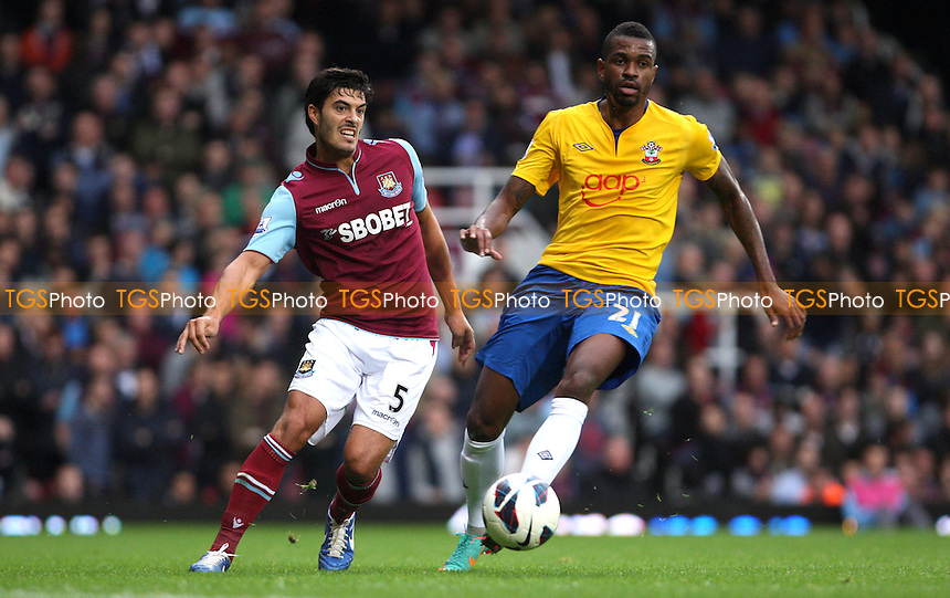 James Tomkins of West Ham and Guly Do Prado of Southampton - West Ham United vs Southampton, Barclays Premier League at Upton Park, West Ham - 20/10/12 - MANDATORY CREDIT: Rob Newell/TGSPHOTO - Self billing applies where appropriate - 0845 094 6026 - contact@tgsphoto.co.uk - NO UNPAID USE.