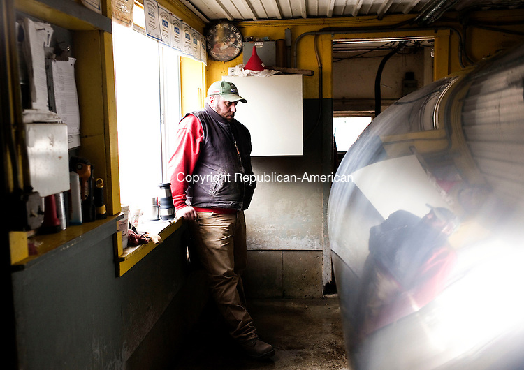 Torrington, CT- 26 December 2015-122615CM03-  Karl Weigold talks about a milk tank at the family farm in Torrington on Saturday.  Weigold said unknown person vandalized the milk room,  emptying approximately  2,000 pounds of milk from the tank.      Christopher Massa Republican-American