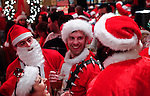 People dressed as santa claus gather in a bar as they take part during the SantaCon party in New York, United States. 15/12/2012. Photo by Kena Betancur/VIEWpress.
