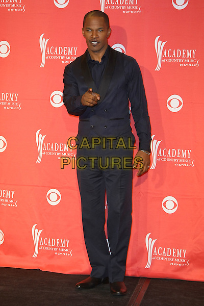 JAMIE FOXX.Pressroom at the 44th Annual Academy Of Country Music Awards held at the MGM Grand Garden Arena, Las Vegas, Nevada, USA..April 5th, 2009.full length black trousers waistcoat blue shirt hand pointing .CAP/ADM/MJT.© MJT/AdMedia/Capital Pictures.