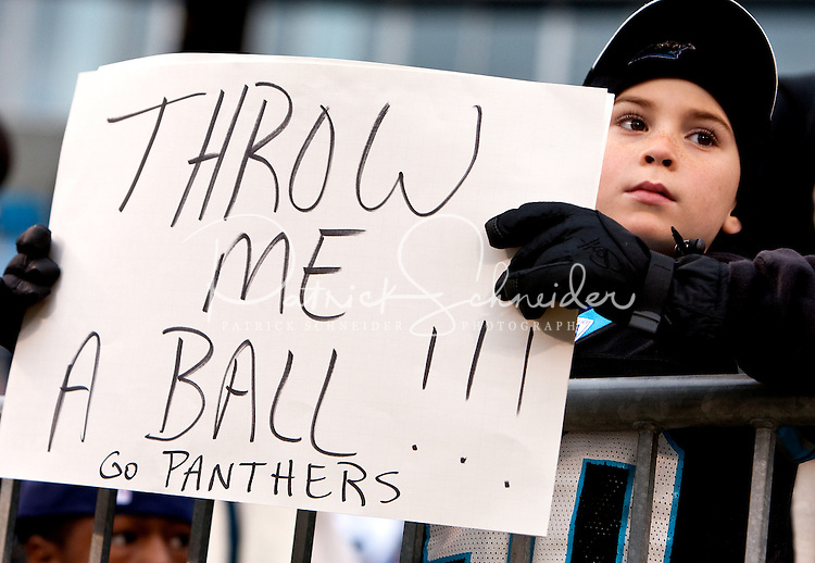 A young fan supports the Carolina Panthers as they play the Denver Broncos during an NFL football game at Bank of America Stadium in Charlotte, NC.