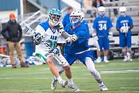 Salve's Zach Makoske,'18, battles Roger Williams during the Men's Lacrosse game action at Gaudet Field in Middletown.