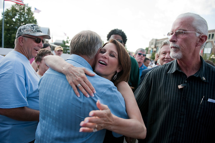 UNITED STATES - AUGUST 12:  Rep. Michele Bachmann, R-Minn., greets Rep. Steve King, R-Iowa, before she addressed a crowd at the Iowa State Fair in Des Moines, Iowa.  (Photo By Tom Williams/Roll Call)