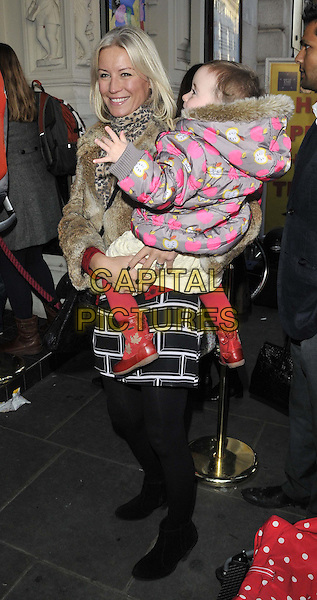 "Denise Van Outen & daughter Betsy .attended the ""Peppa Pig's Treasure Hunt"" press night,  Criterion theatre, Piccadilly, Piccadilly Circus, London, England, 2nd December 2011..full length  smiling black beige fur jacket tights dress  ankle boots carrying holding child kid mother family .CAP/CAN.©Can Nguyen/Capital Pictures."