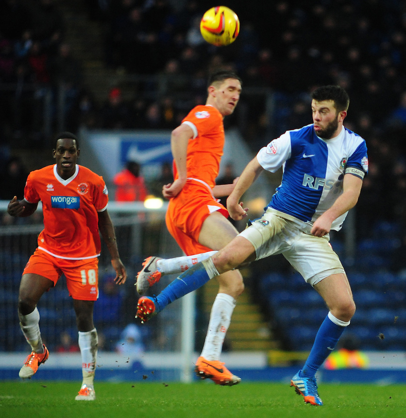 Blackpool's Chris Basham vies for possession with Blackburn Rovers' Grant Hanley <br /> <br /> Photo by Chris Vaughan/CameraSport<br /> <br /> Football - The Football League Sky Bet Championship - Blackburn Rovers v Blackpool - Saturday 1st February 2014 - Ewood Park - Blackburn<br /> <br /> &copy; CameraSport - 43 Linden Ave. Countesthorpe. Leicester. England. LE8 5PG - Tel: +44 (0) 116 277 4147 - admin@camerasport.com - www.camerasport.com