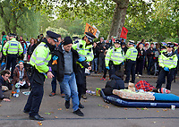 Police arrest Extinction Rebellion protesters in London on 09 October 2019 in London, England.<br /> .<br /> Protesters plan to blockade the London government district for a two week period, as part of 'International Rebellion' taking place in over 60 cities around the world, calling for decisive and immediate action from governments in the face of climate and ecological emergency. <br /> .<br />  Photo by Alan  Stanford.
