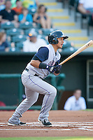 Colorado Springs Sky Sox shortstop Cristhian Adames (10) watches the ball after batting at the Chickasaw Bricktown Ballpark during the Pacific League game against the Oklahoma City RedHawks on August 3, 2014 in Oklahoma City, Oklahoma.  The RedHawks defeated the Sky Sox 8-1.  (William Purnell/Four Seam Images)