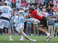 Baltimore, MD - April 28, 2018: Johns Hopkins Blue Jays Joel Tinney (55) gets clotheslined by Maryland Terrapins Bryce Young (41)  during game between John Hopkins and Maryland at  Homewood Field in Baltimore, MD.  (Photo by Elliott Brown/Media Images International)