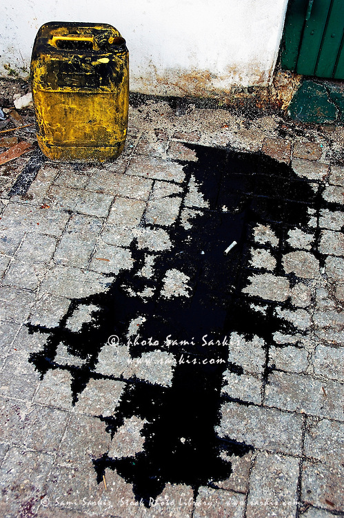 Black oil puddle on the cobblestones, Malé, Maldives.