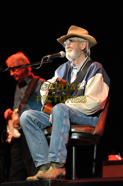 Don Williams .performing live in concert at Hammersmith Apollo, London, England, UK, 4th May 2012..music gig on stage full length sitting down playing guitar jeans cowboy boots hat glasses beard facial hair microphone .CAP/MAR.© Martin Harris/Capital Pictures.
