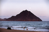 Moon rising over a beach near Aden on the southern coast of Yemen, where an extraordinary natural deep water harbour is formed by the crater of an extinct volcano. Its location near the entrance to the Red Sea meant that for centuries it dominated east-west trade and was once the British colonial capital of Yemen.