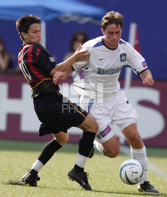 The MetroStars' Joselito Vaca battles for the ball with the Earthquake's Todd Dunivant. The San Jose Earthquakes were shut out by  the NY/NJ MetroStars 2-0 at Giant's Stadium, East Rutherford, NJ, on July 10, 2004.