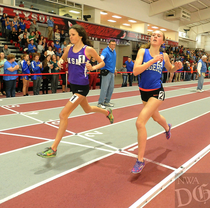 NWA Democrat-Gazette/MICHAEL WOODS &bull; @NWAMICHAELW<br /> Alex Ritchey with Mount St. Mary's and Lisa<br /> Lauschke, from Rogers High, cross the finish line to finish 1st and 2nd in the Girls 1600 Meter Run at the 5A-7A State Indoor track meet Saturday, February 6, 2016 at the Tyson Indoor Sports Complex in Fayetteville.