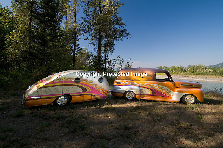 1948 Ford Panel truck pulling a matching psychedelic colored unknown 1940 factory built teardrop vintage travel trailer.