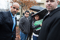 Copyright Justin Cook | December 10, 2013 - FBI employees escort Carlos Salamanca and Evelin Huerta (Jesus' sister) into their building to receive their petitions from Presente.org. Friends and family of Jesus Huerta gather at the FBI Resident Agency Raleigh in Cary to deliver a petition of 18,000 signatures asking the Department of Justice to investigate the Durham Police Department for civil rights violations. Huerta, 17, died of a gunshot wound while in Durham Police custody on November 19, 2013.