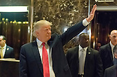 President-elect Donald Trump greets appears in Trump Tower lobby follwing his meeting with Son Masayoshi, CEO and founder of SoftBank, in New York, NY, USA on December 6, 2016. (Photo by Albin Lohr-Jones)<br /> Credit: Albin Lohr-Jones / Pool via CNP