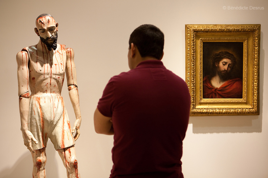 """May 14, 2011 - Mexico City, Mexico - Anonymous' Sculpture of Jesus Nazarenus and Bartolome Esteban Murillo's painting """"Ecce Homo"""" (1670). Mexican billionaire Carlos Slim newly built museum Soumaya that houses his art collection which includes the second largest grouping of Rodin sculptures. It also holds many of the best known European artists from the 15th to the 20th Century, Mexican art, religious relics, historical documents and coins. Designed by Slim's 38-year old son-in-law, Fernando Romero, the six-floor, 183,000 square-foot Soumaya Museum is shaped like a wonky futuristic hourglass layered with 16 000 aluminum hexagons. The $34 million museum is part of an enormous complex including headquarters for the magnate's telecom corporations Grupo Carso and Telcel, a shopping mall and luxury apartment housing. The Museum opened to public in march 2011 and it is located in Polanco Plaza Carso of Mexico City. Photo crédito: Benedicte Desrus"""